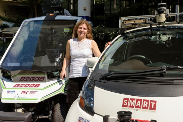 Professor Daniela Rus stands with autonomous SMART vehicles on the MIT campus. Photo: SMART