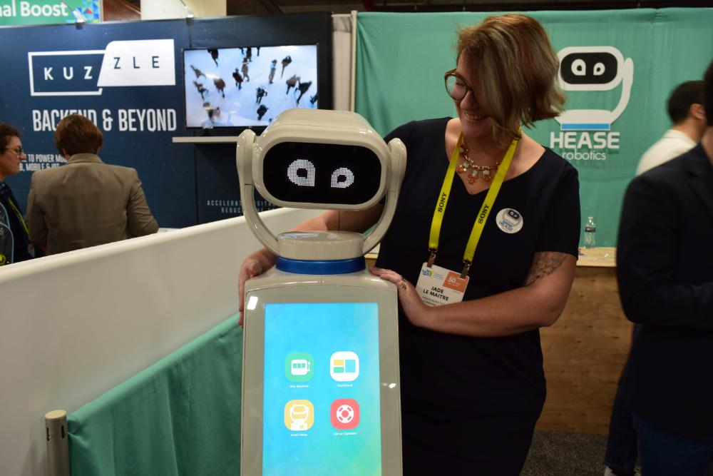 Jade Le Maître with Heasy hospitality robot, from Hease robotics.