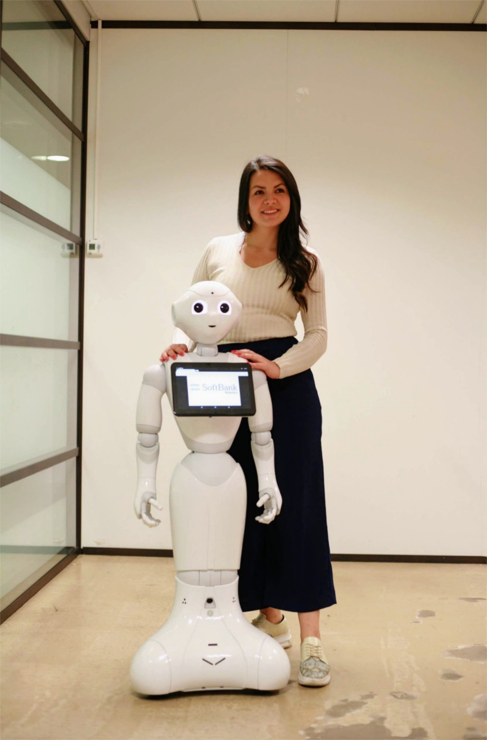 Natalia Calvo with Pepper robot