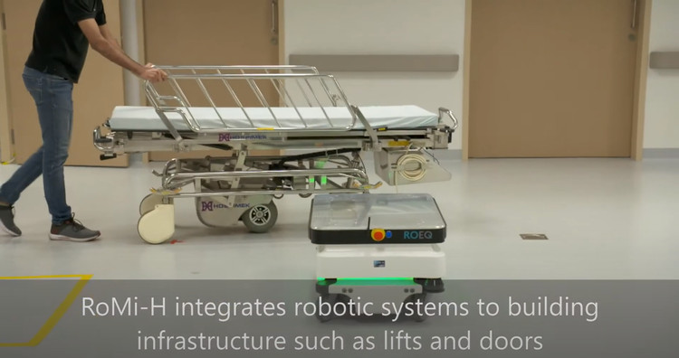 RoMi-H robot with hospital bed behind
